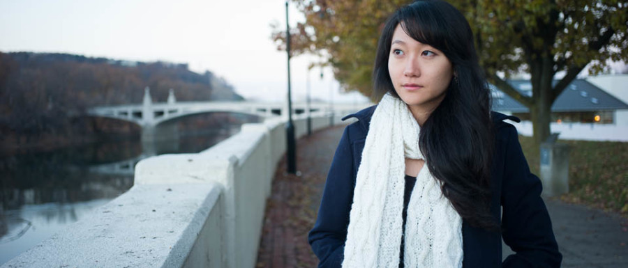 Portrait of YaeJin Oh in Binghamton New York near the Clinton Street Bridge