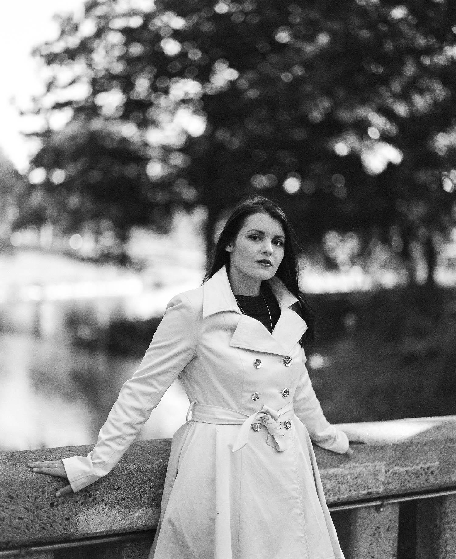 Whitney leaning against the bridge at Deering Oaks Park