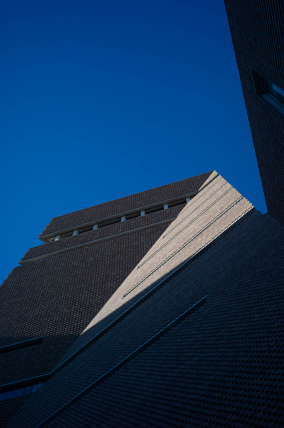 A triangle of sunlight fills a creased building at the Tate Modern museum