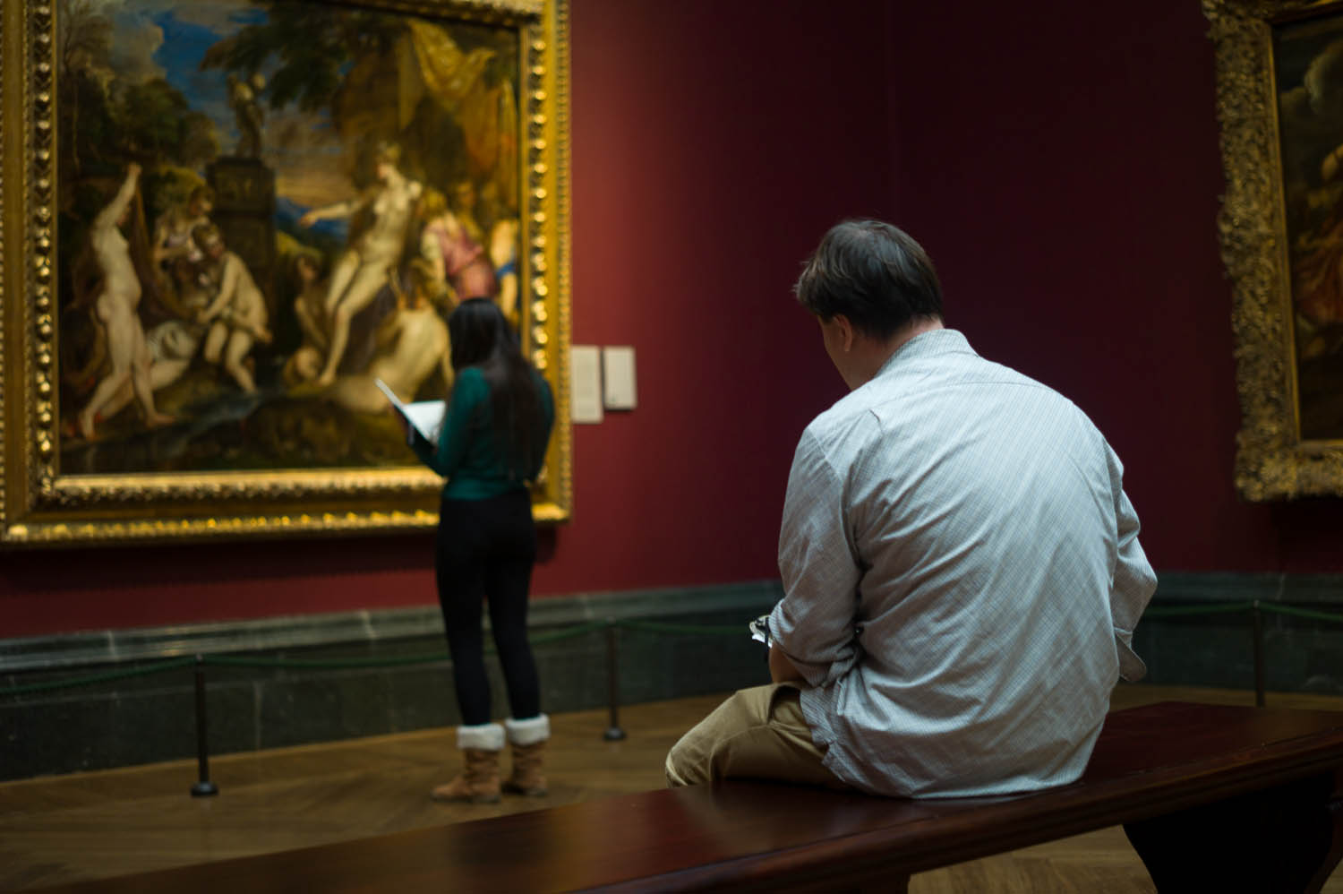 Some artists sketch the painting in front of them at the museum