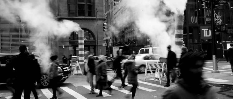 Pedestrians use a crosswalk in NYC