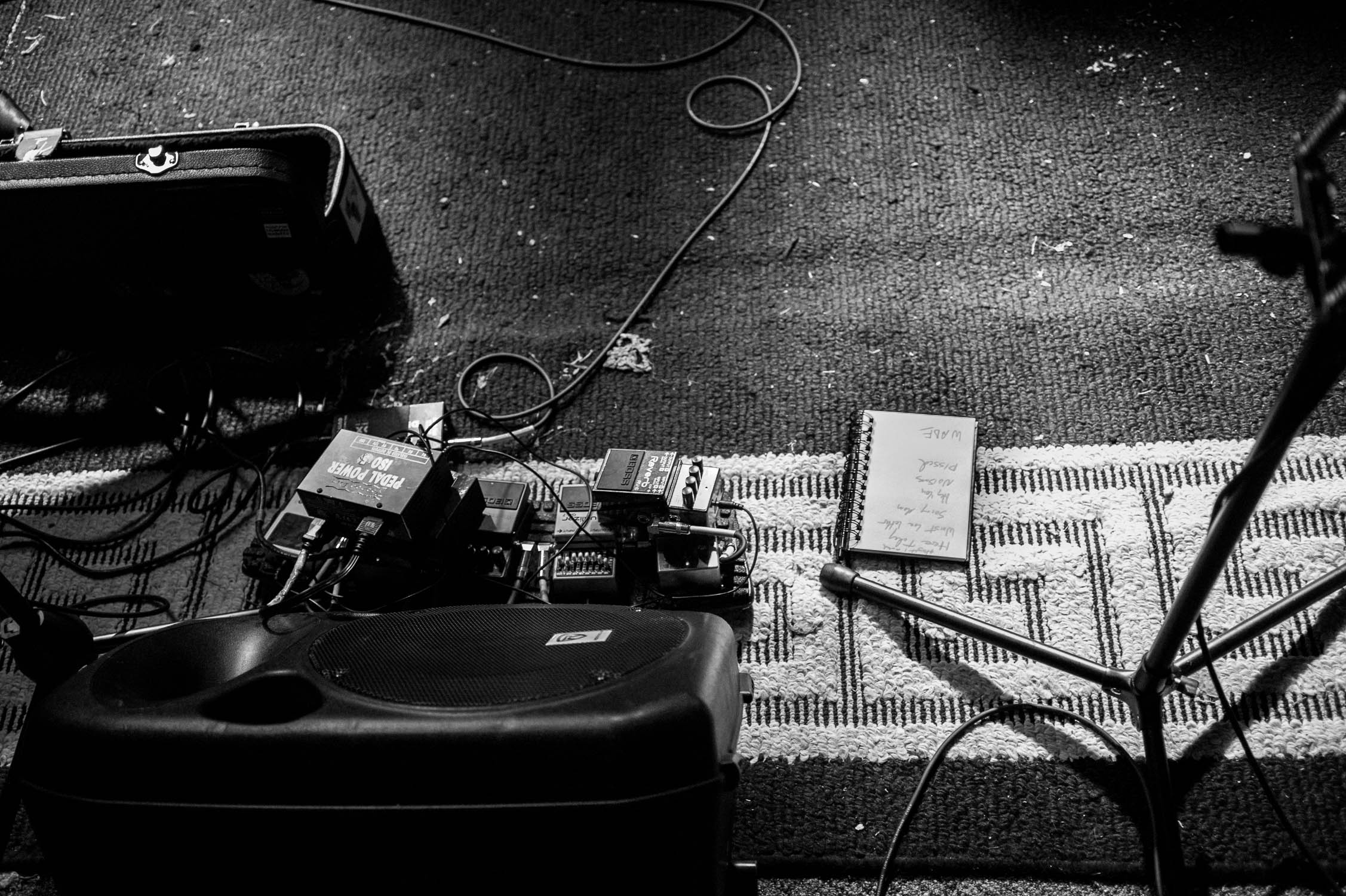 Effects pedals and a set list before a show at Avenue D.I.Y.