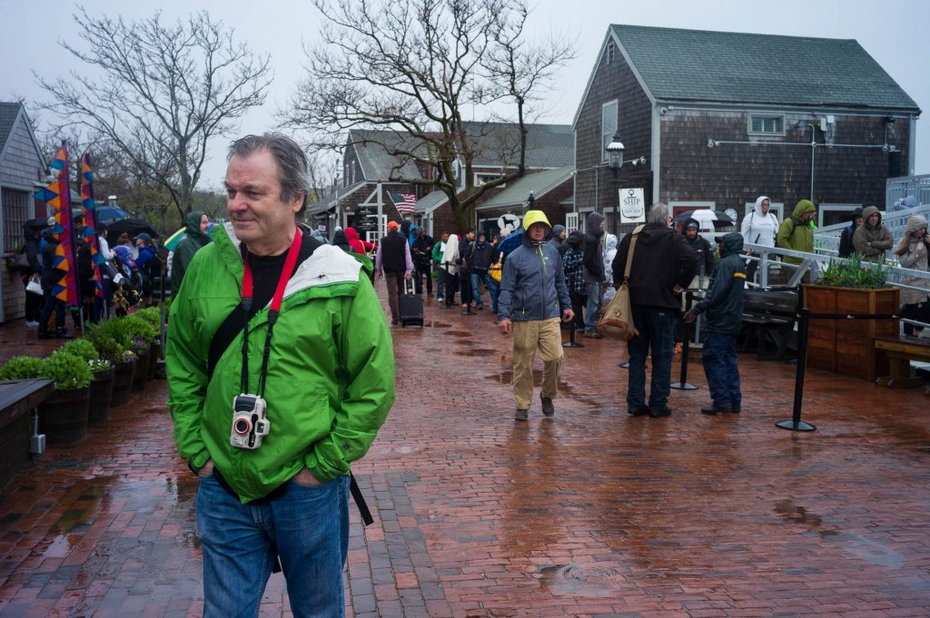 Thomas Risberg in Nantucket in May 2017 for NEWLK with a green rain jacket and waterproof camera.
